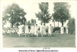 Women in Grecian dress dancing at a June celebration, The University of Iowa, 1920