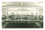University orchestra with cello soloist in Main Lounge of Iowa Memorial Union, The University of Iowa, 1930s
