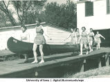 Students carrying a canoe to the river on May Day, The University of Iowa, May 1, 1937