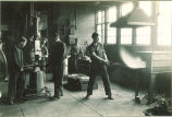 Mechanical engineering students in forge shop, The University of Iowa, 1920s