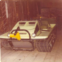 The Trackester snow plow parked in the barn
