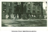 Women in Greek costume dancing on the Pentacrest lawn, The University of Iowa, 1920