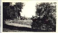 Many men loading hay wagon in hayfield