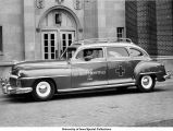 Ambulance and driver, The University of Iowa, 1948