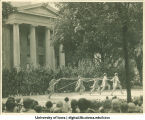 Women dressed as fairies performing in front of the Old Capitol at a June celebration, The University of Iowa, 1920