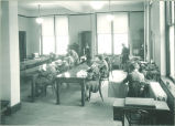 Sewing and ironing in home economics class, The University of Iowa, 1920s