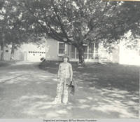 John, Jr. standing on lane with towel in hand