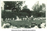 Women dressed as flowers dancing on lawn for celebration, The University of Iowa, 1920s?