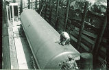 Workers installing large underground storage tank, The University of Iowa, 1940s