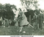 Students rolling balls on the lawn, The University of Iowa, 1937