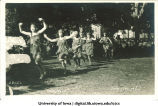 Women running on the Pentacrest at a June celebration, The University of Iowa, 1920