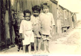 Children in front of boxcar, Holy City, Bettendorf, Iowa, 1920s