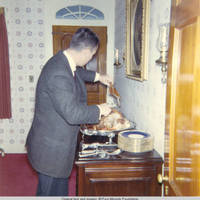 John, Sr. carving the turkey in dinning room