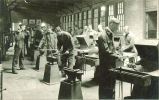 Mechanical engineering students working at forges, The University of Iowa, 1920s