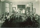 School children having lunch in cafeteria, The University of Iowa, April 1928