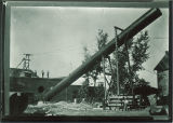 Workmen raising smokestack into position, The University of Iowa, 1890s