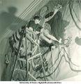 Student assembling modern art mural, The University of Iowa, March 1940