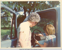 Bill supervising John, Jr. in truck driver's seat