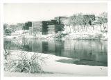 Winter view of dormitories across the Iowa River, the University of Iowa, ca. 1960