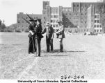 Governor Daniel Webster Turner presenting awards to cadets during Governor's Day ceremony, The University of Iowa, 1931
