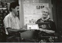 Mike Lewilke Presents Retirement Certificate to Dorothy Davis