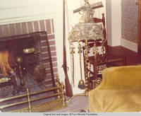 View of windmill fire place tool set in living room