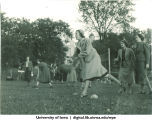 Students rolling balls across the lawn, The University of Iowa, 1937