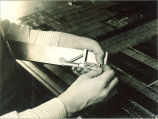 Movable type on composing stick, The University of Iowa, 1920s