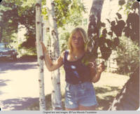 Liz standing in the trees