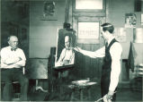 Sidney Dickinson painting a man's portrait, The University of Iowa, 1910s