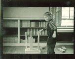 Small boy building a tower with wood blocks, The University of Iowa, February 22, 1938