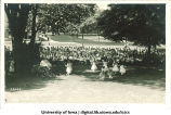 Women dancing on the Pentacrest in front of a large audience at a June celebration, The University of Iowa, 1920