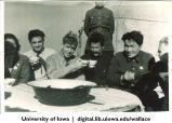 Henry Wallace drinking festive bowl of kumis with Kazakhs at nomadic sheep ranch, Siberia, 1944
