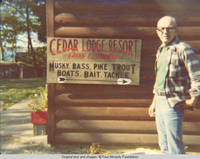 John Hedbereg standing by Cedar Lodge sign