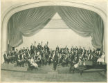 University orchestra seated in Macbride Hall auditorium, The University of Iowa, 1920s