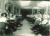Patients in dental clinic in Old Dental Building, The University of Iowa, 1900s