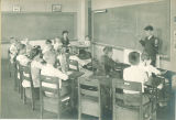 Student giving presentation to class, The University of Iowa, 1919