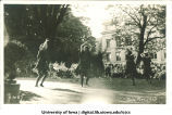 Two women dancing on the Pentacrest at a June celebration, The University of Iowa, 1920