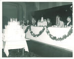 Cake with candles and the head table for the 100th anniversary of the Old Capitol party, The University of Iowa, 1947