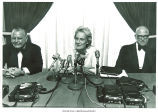 Mary Louise Smith at press conference flanked by Assemblyman Joseph Margiotta and Richard Rosenbaum, Nassau County, N.Y., June 19, 1975
