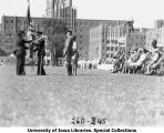 Governor's Day ceremony, presentation of American Flag to woman,  The University of Iowa, 1931