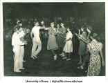 Audience watches couples dance, The University of Iowa, 1940s