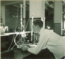 Student at work in pharmacy laboratory, The University of Iowa, 1930s