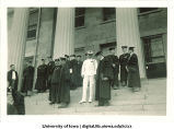 University President Walter Jessup, front left, and other commencement officials on west portico of Old Capitol, The University of Iowa, June 1934