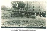 University graduates walking down Washington Street past Engineering Building, The University of Iowa, 1910s
