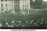 Women dancing with large scarves near a maypole on the Pentacrest lawn, The University of Iowa, June 1924