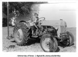 Wesley and Ray Maynard on tractor at Birkby farm, Shenandoah, Iowa, 1950s