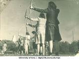 Students practicing archery, The University of Iowa, 1940s