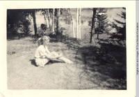 Vidie Burden sitting with unknown man in background