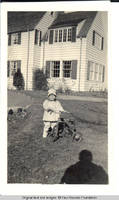 Vidie Burden with tricycle in front of White house